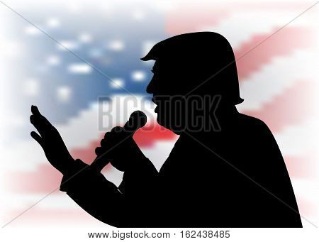 20 DEC, 2016: President Donald Trump portrait on US flag background. Donald Trump black silhouette with a microphone speaking to the audience