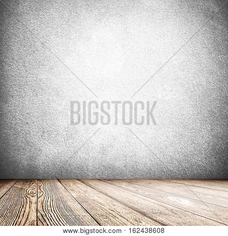 Abstract blank board background texture with old weathered dark stucco black paint stone cement wall in rural room Grungy cold rock surface in hard grime empty place with wood panel light brown floor
