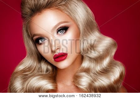 Beautyful girl with bright make up and beautiful hairstyle. Red lips