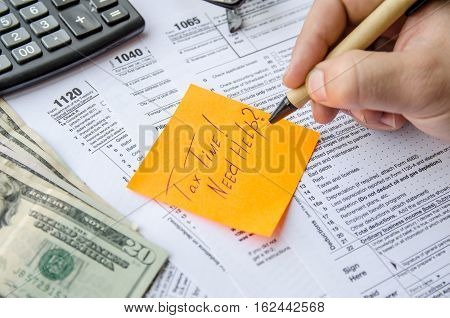 Tax form 1040 1120 1065 with pen calculator and sticker