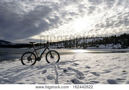 bicycles at the lake shore tranquil winter scenery lake
