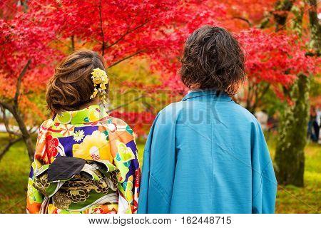 Japanese Couple Wear Kimono At Autumn