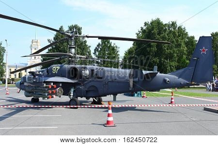 St. Petersburg Russia Jule 5 2013 Attack helicopters Ka-52 Alligator arms exhibition
