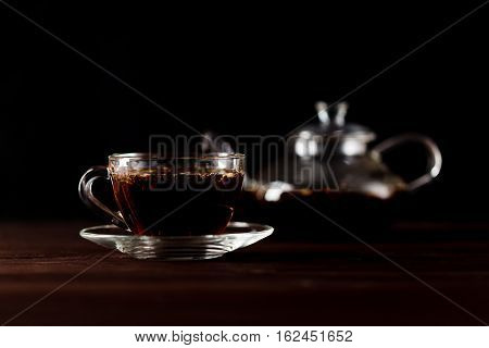 Transparent Teacup With Black Tea In Low Key