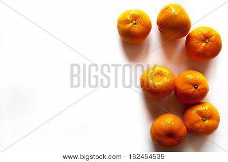 Mandarin isolated on white background. Snowy beautiful nature