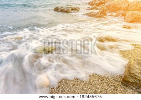 Long Exposure Shot. Sea Scape With Stone Beach At Thailand