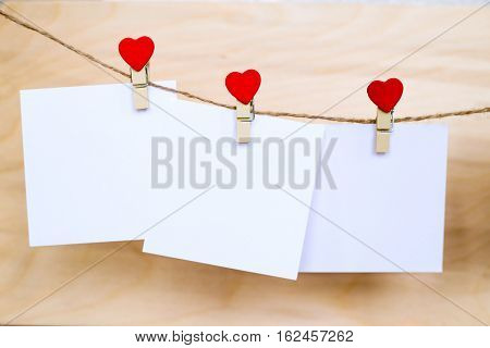 White Paper Stickers Hanging On Heart Shape Pins And Pack-thread