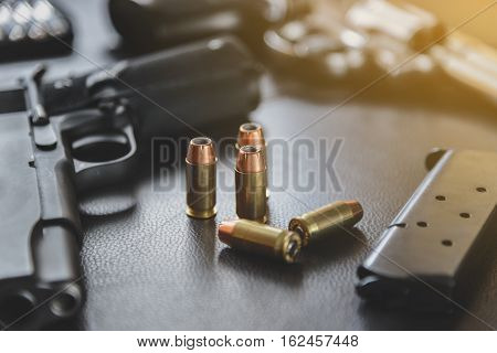 .45 Caliber Hollow Point Bullets Near Handgun And Magazine On Leather Furniture