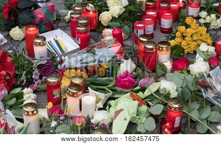 Berlin Germany - december 20 2016: Candles and flowers at the Christmas Market in Berlin the day after the terrorist attack.