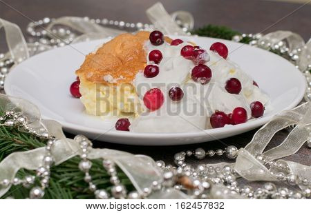 christmas pudding with whipped cream and fresh berries