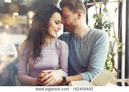 Romantic Couple Bonding In Cafe