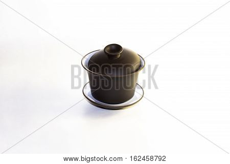 The Chinese ceramic gaiwan for holding a tea ceremony on a white background.