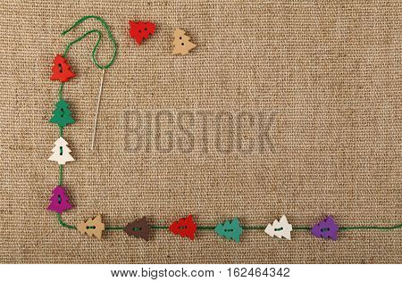 Christmas Template Of Craft Buttons Over Canvas