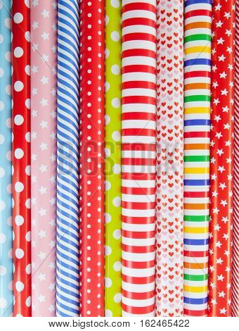 Cheerful background made from rolls of colorful wrapping paper