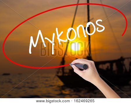 Woman Hand Writing Mykonos With A Marker Over Transparent Board