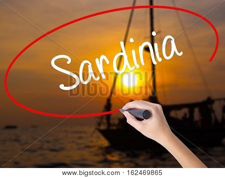 Woman Hand Writing Sardinia  With A Marker Over Transparent Board