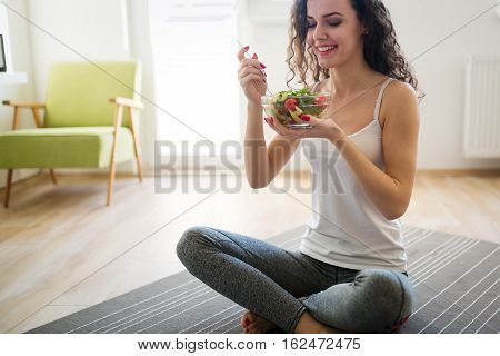 Woman Eating Healthy After Working Out