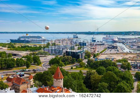 Tallinn Estonia - June 02 2016: view from medieval Centre of Tallinn city to the port with modern cruise liner ships. Tallinn Estonia.
