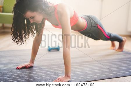 Woman Exercising At Home Doing Pushups