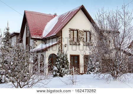Small beautiful house in a cottage settlement. Winter morning.
