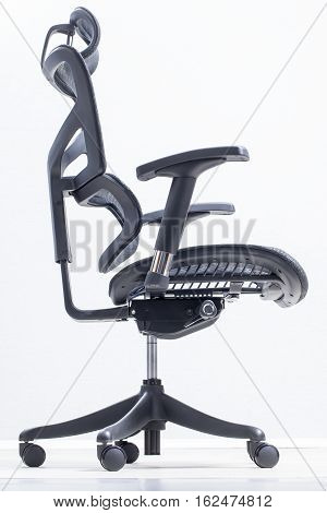 orthopedic chair ergonomic computer workstation on a gray background poster