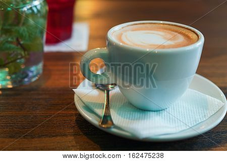 A Cup Of Cappuccino On The Table At The Bar.