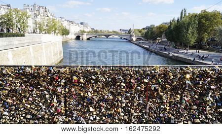 PARIS FRANCE - SEPTEMBER 27 2015: Many love locks at the Archbishop's (Pont de l'Archeveche) bridge in Paris France