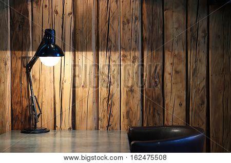 Vintage Black Desk Lamp On Wood Background