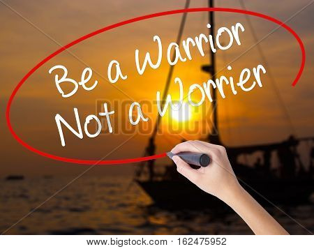 Woman Hand Writing Be A Warrior Not A Worrier With A Marker Over Transparent Board