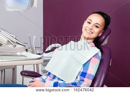 Woman Patient With Perfect Straight White Teeth Waiting For Dentist