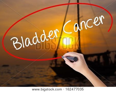 Woman Hand Writing Bladder Cancer With A Marker Over Transparent Board