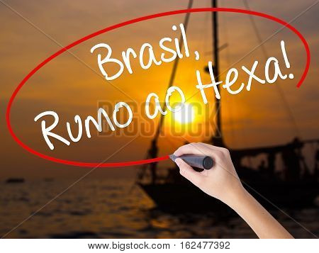 Woman Hand Writing Brasil, Rumo Ao Hexa! With A Marker Over Transparent Board.