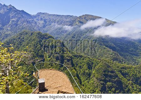 Picturesque aerial panorama of mountains and rainforest hills on Madeira island Portugal. View from Balcoes levada viewpoint balcony