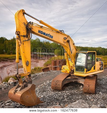 MAITLAND CANADA - SEPTEMBER 07 2014: Komatsu is a Japanese multinational corporation manufacturing heavy industrial and military equipment. Komatsu is headquartered in Japan.
