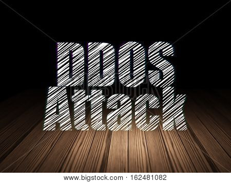 Security concept: Glowing text DDOS Attack in grunge dark room with Wooden Floor, black background