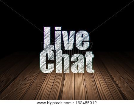 Web development concept: Glowing text Live Chat in grunge dark room with Wooden Floor, black background