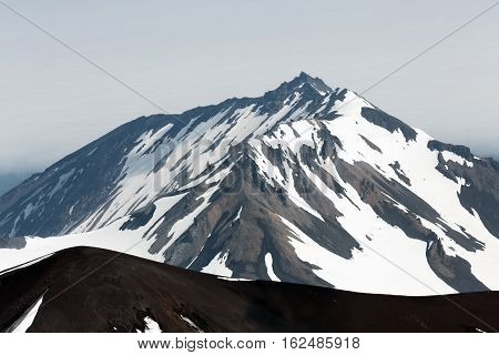 Volcanic landscape of Kamchatka Peninsula: View to top of Kozelsky Volcano from crater of Avacha Volcano. Avachinsky-Koryaksky Group of Volcanoes Kamchatka Region Russian Far East Eurasia.