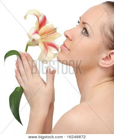 beautiful woman with lily flower on a white background