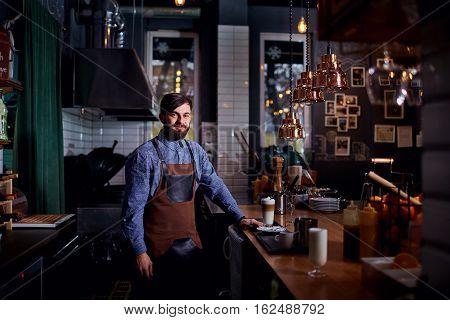 Barman barista uniform making coffee tea cocktails in the bar, restaurant, shop.