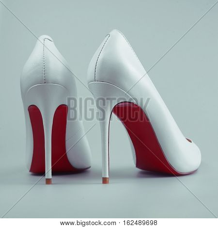 summer white female shoes in grey background