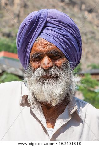 MANIKARAN, INDIA. 4 June 2009: Rural residents in daily life.  Closeup portrait of an old Sikh  nearby at the Sikh Gurdwara. Manikaran, district Kullu in Himachal Pradesh, India.