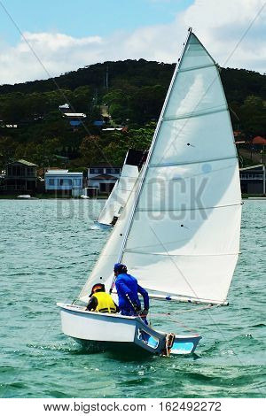 Children sailing activities at Belmont Lake Macquarie New South Wales Australia.