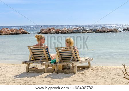 Two Girls In A Front Row Seats At The Beach
