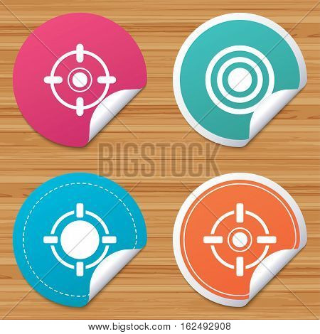 Round stickers or website banners. Crosshair icons. Target aim signs symbols. Weapon gun sights for shooting range. Circle badges with bended corner. Vector