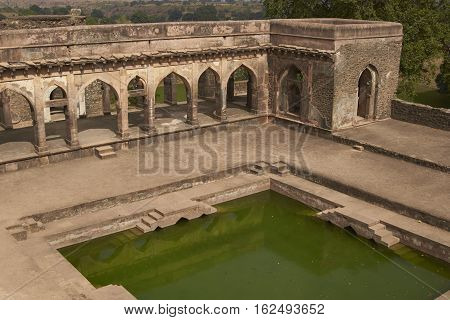 MANDU, INDIA - NOVEMBER 17, 2008: Historic Baz Bahadur's palace inside the hilltop fort of Mandu in Madyha Pradesh, India. Built in stages from 15th century onwards.
