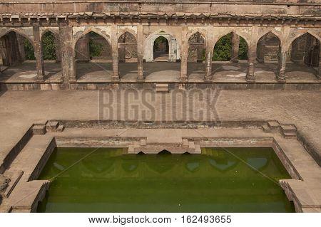 MANDU, INDIA - NOVEMBER 17, 2008: Historic Baz Bahadur's palace inside the hilltop fort of Mandu in Madyha Pradesh, India. Built in stages from 15th century onwards.