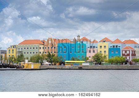 Willemstad, Curacao Handelskade With Colorful Facades And Queen Emma Bridge