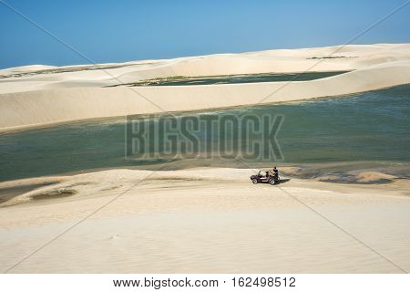 Jericoacoara Ceara state Brazil - July 2016: Buggy with tourists traveling through the desert Jericoacoara National Park