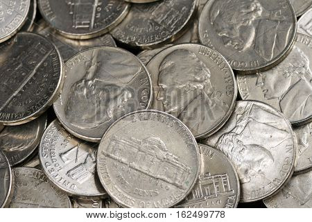 A close up image of American nickels
