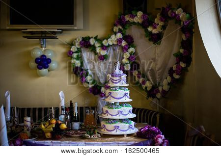 wedding cake wedding decorated table wedding ceremony fruits grapes bananas apples drink sandwiches